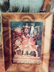 A framed image of this holy Dorje Shugden statue